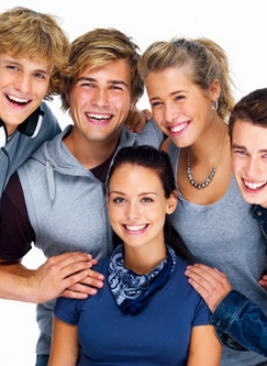Group of kids smiling with their invisible braces.
